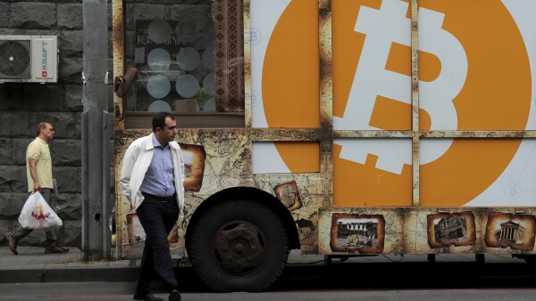 FILE PHOTO: A board with the logo of Bitcoin is on display in Yerevan