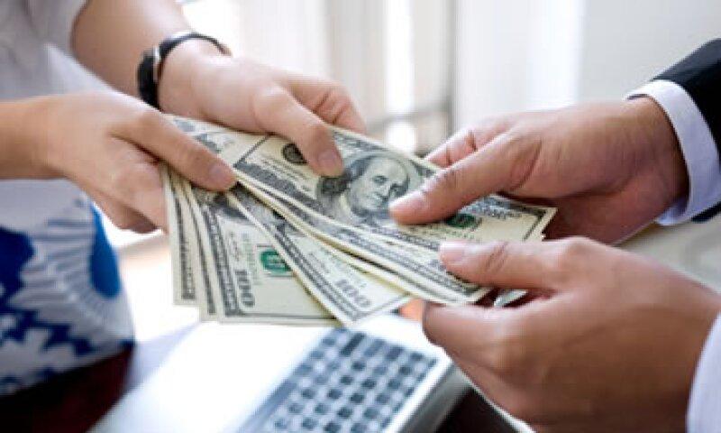 Banco Base estimó que el tipo de cambio oscile entre 12.91 y 12.98 pesos por dólar. (Foto: Getty Images)
