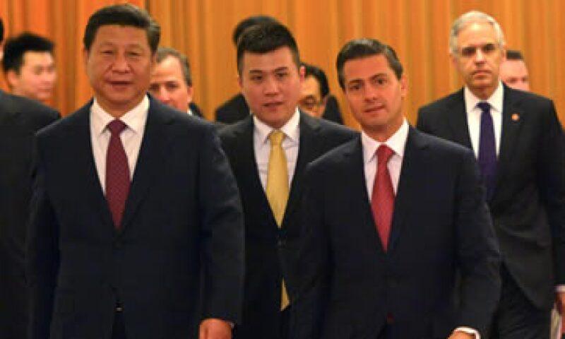 Durante la visita de Estado de Peña Nieto a China, Pemex firmó acuerdos de cooperación con la petrolera china CNOOC y el banco China Development Bank. (Foto: Notimex )