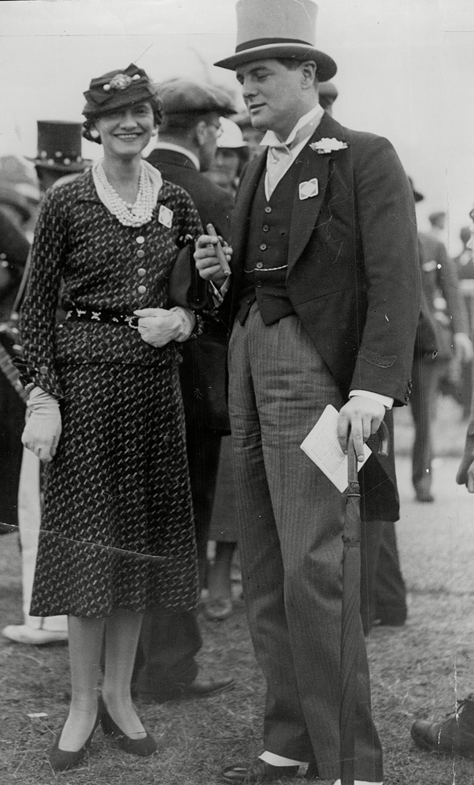 Politician Randolph Churchill With Fashion Designer Coco Chanel At Ascot Randolph Frederick Edward Spencer-churchill Mbe (28 May 1911 A 6 June 1968) Was The Son Of British Prime Minister Winston Churchill And His Wife Clementine. He Was A Conservativ