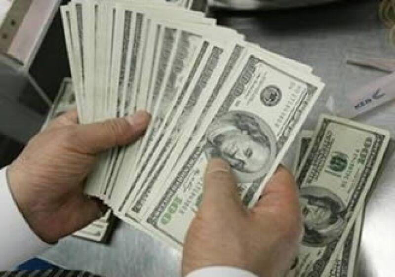 Los préstamos de los bancos de EU descendieron al cierre de la semana pasada. (Foto: Reuters)