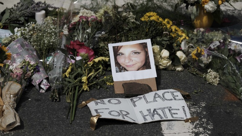 Flowers and a photo of car ramming victim Heather Heyer