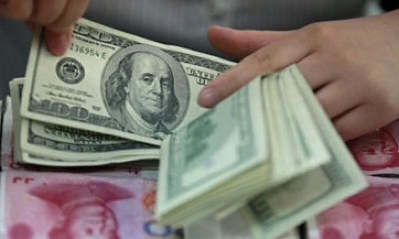 Banxico informó que el tipo de cambio es de 13.0141 pesos para solventar obligaciones denominadas en moneda extranjera. (Foto: Thinkstock)