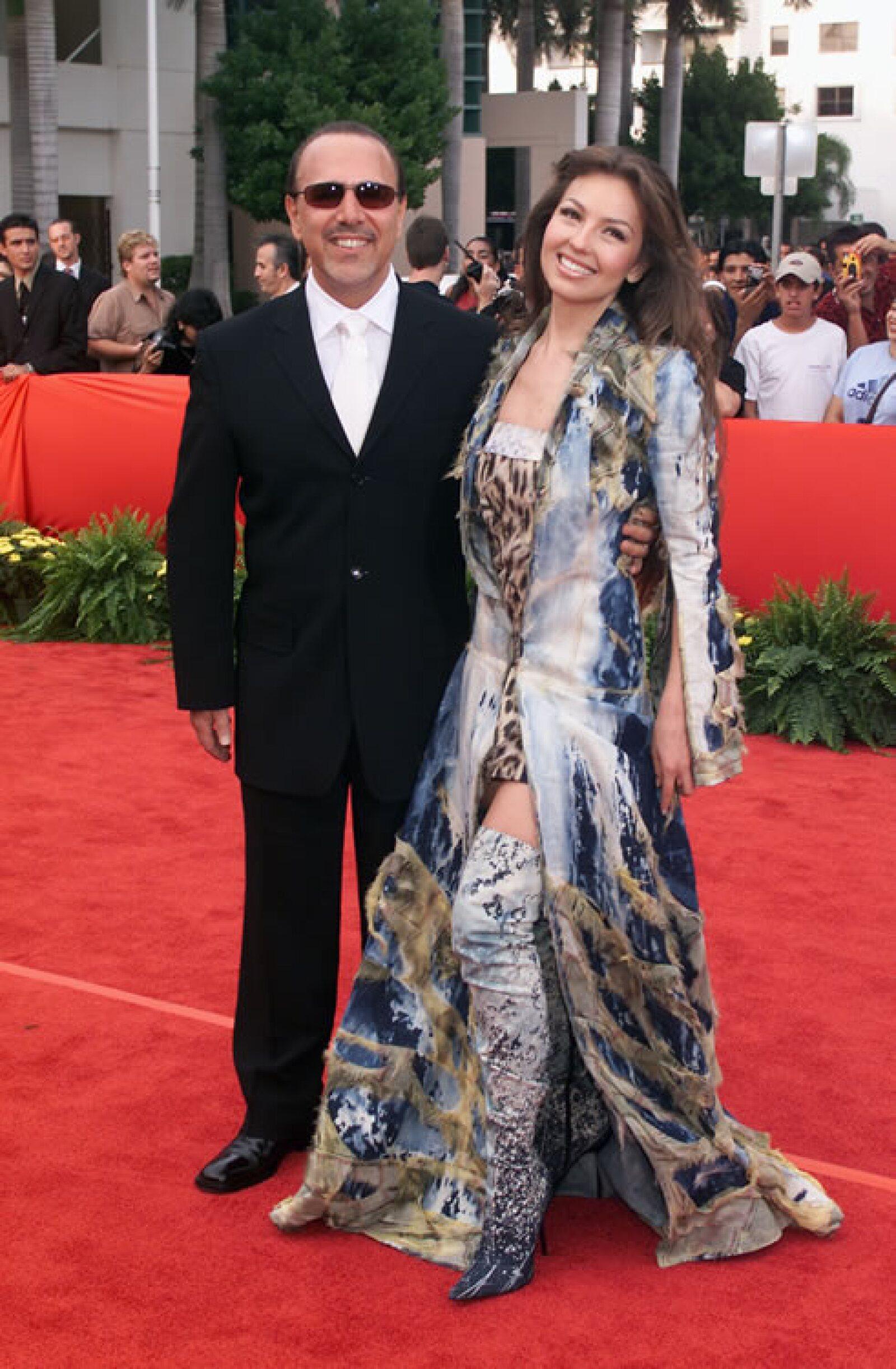 Luego de siete años de matrimonio la pareja dio el anuncio de que serían padres, lo que significaba el primero para Thalía y el tercero para Tommy.