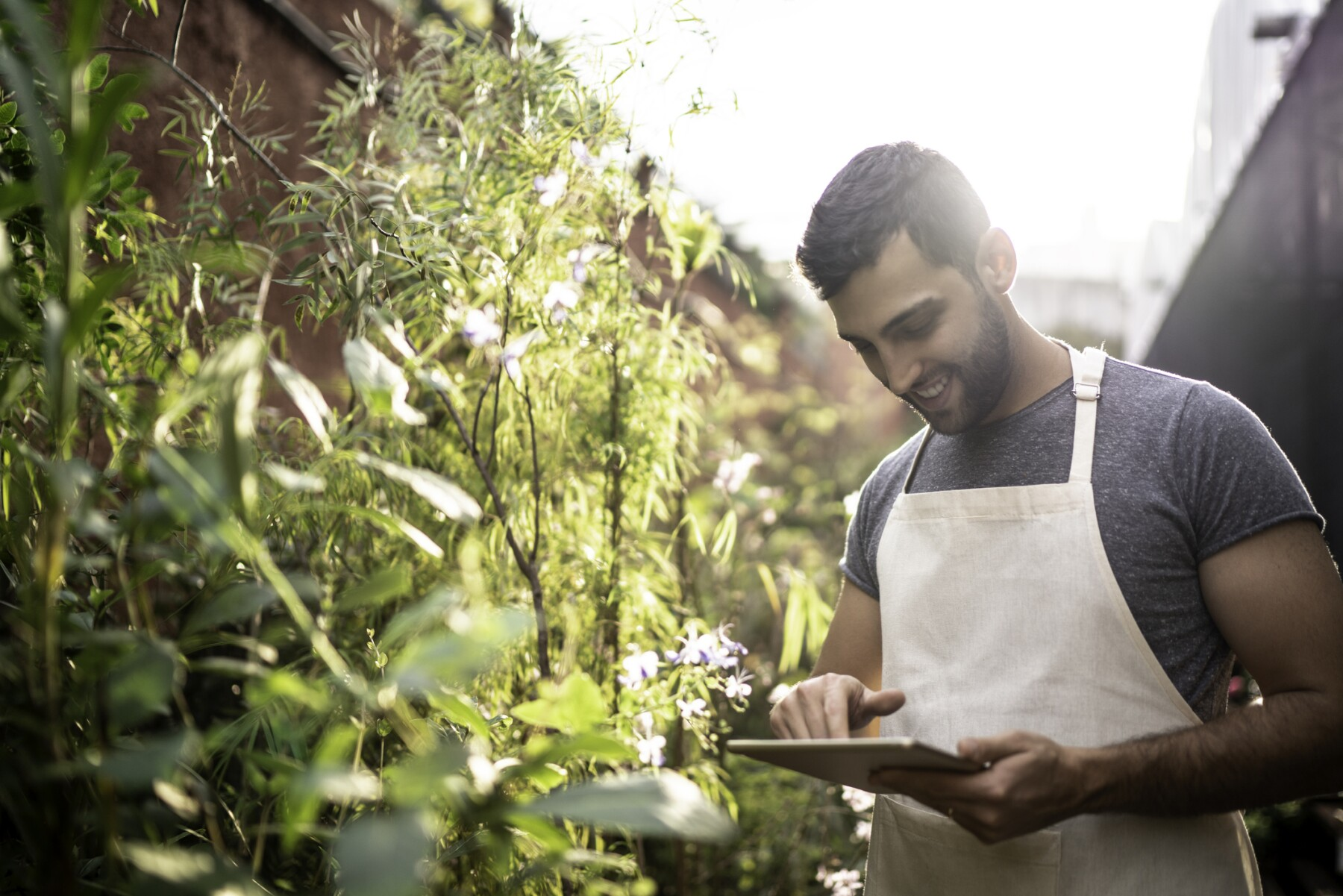 Young florist using a digital tablet