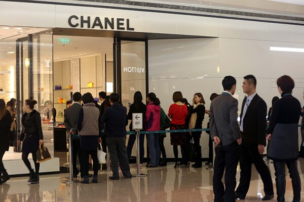 Long lines form at stores after Chanel cuts prices, Shanghai, China - 19 Mar 2015