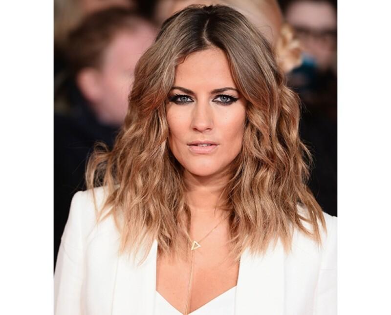 Caroline Flack fue relacionada a Harry tras una fiesta de X Factor en la que parecieron entenderse muy bien.