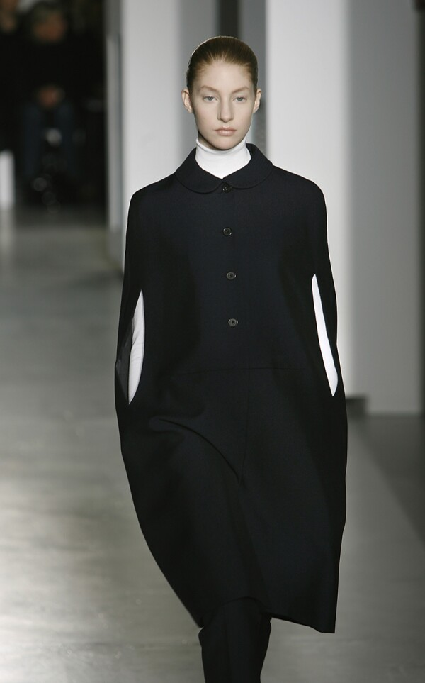 MILAN ? FEBRUARY 20: Models walk down the catwalk during the Jill Sander by Raf Simons' Autumn/Wint