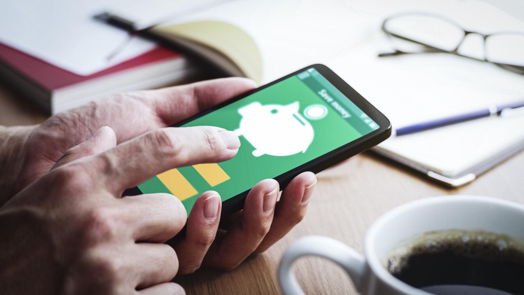 Piggy bank icon on smartphone screen.