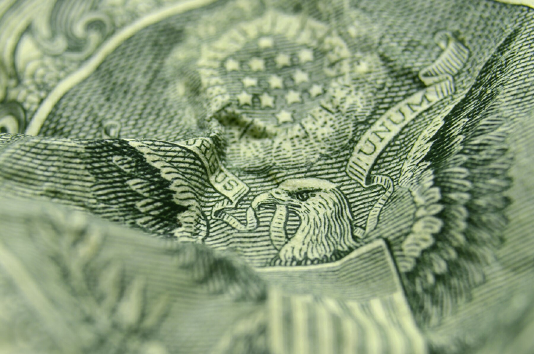 Selective focus on the eagle's face from the reverse of the US 1 dollar bill.