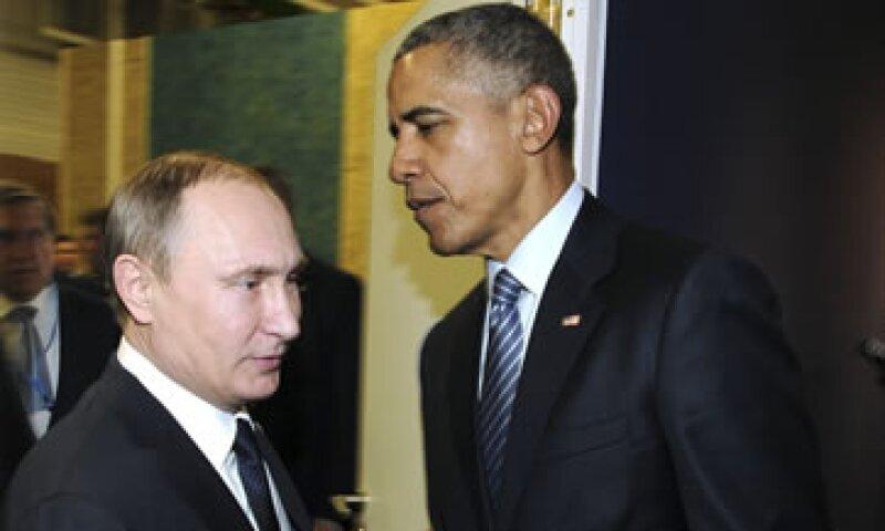 Putin (izq) y Obama se reunieron durante 30 minutos en París. (Foto: Reuters )