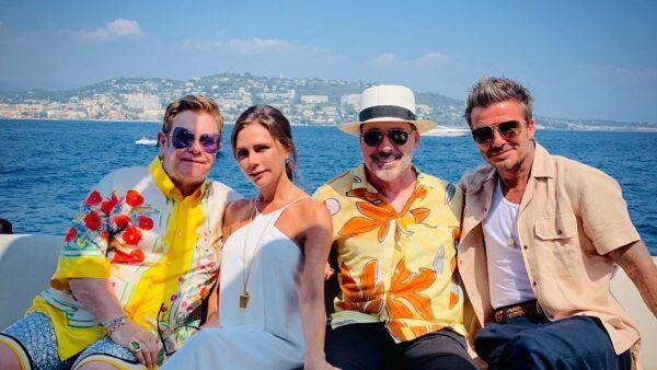 Los Beckham y Elton John