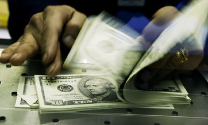 El tipo de cambio podría ubicarse entre 13.07 y 13.15 pesos por dólar, estima Banco Base. (Foto: Getty Images)