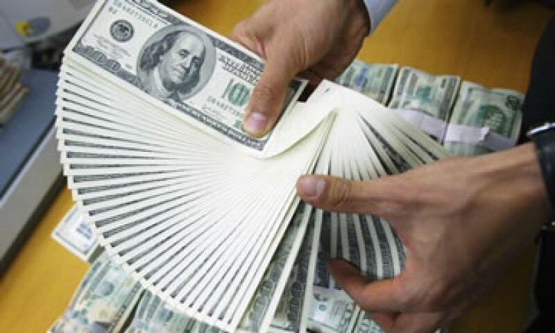 El Banco de México fijó el tipó de cambio en 13.0112 pesos para solventar obligaciones denominadas en moneda extranjera. (Foto: Getty Images)