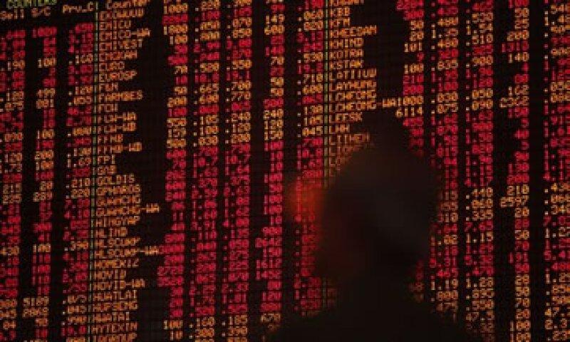 La agitación de los mercados añade presión a la Fed de cara a su reunión de política monetaria de este martes. (Foto: AP)