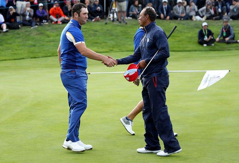 Jon Rahm y Tiger Woods