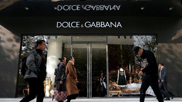 FILE PHOTO: People walk past a Dolce & Gabbana store at a shopping complex in Shanghai