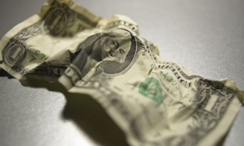 Los analistas prevén que en 2012 la economía estadounidense crezca un modesto 2.4%. (Foto: Thinkstock)