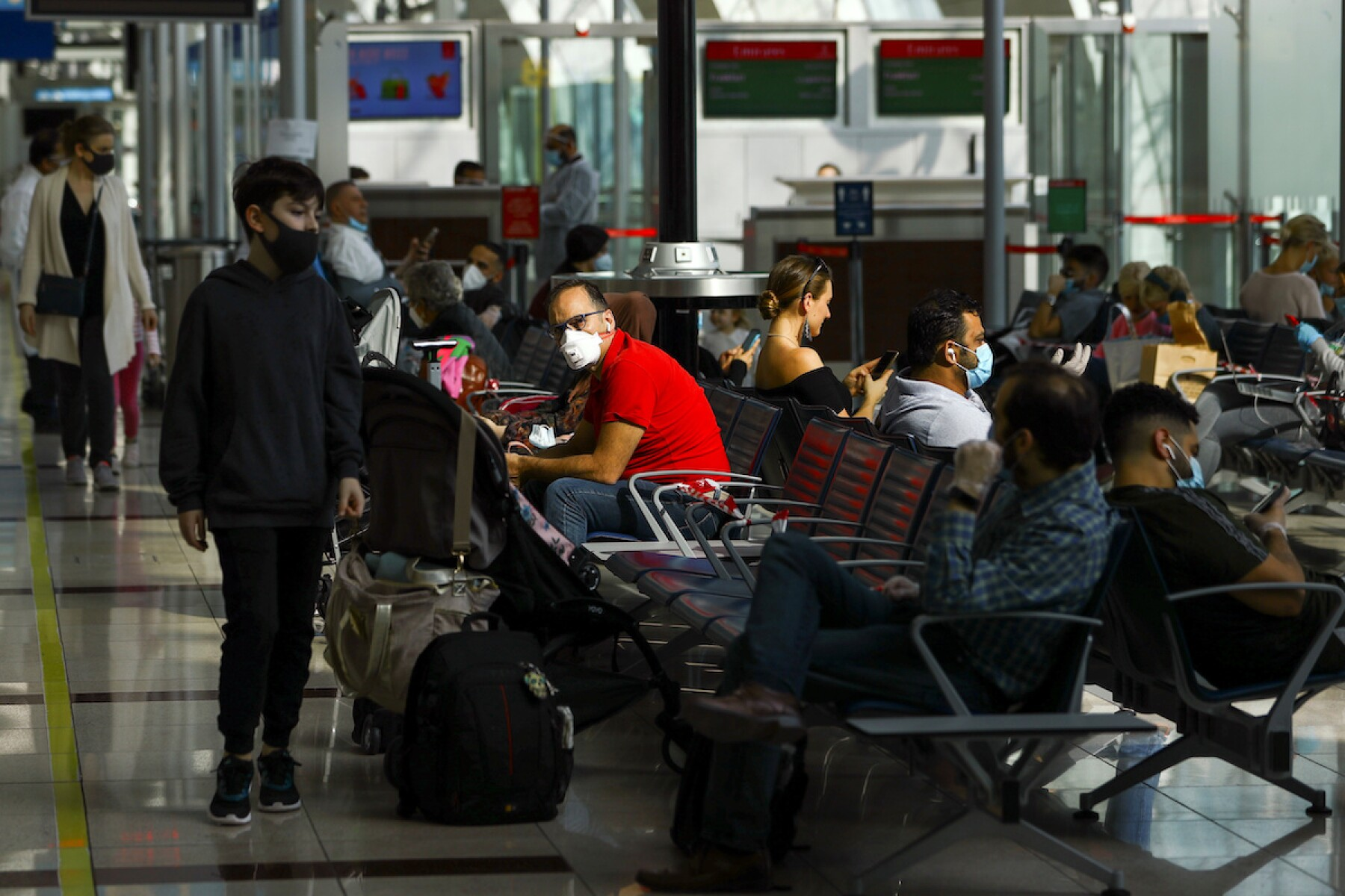 Passengers wait before boarding at Dubai International Airport, as Emirates airline resumed limited outbound passenger flights amid the outbreak of the coronavirus disease (COVID-19) in Dubai
