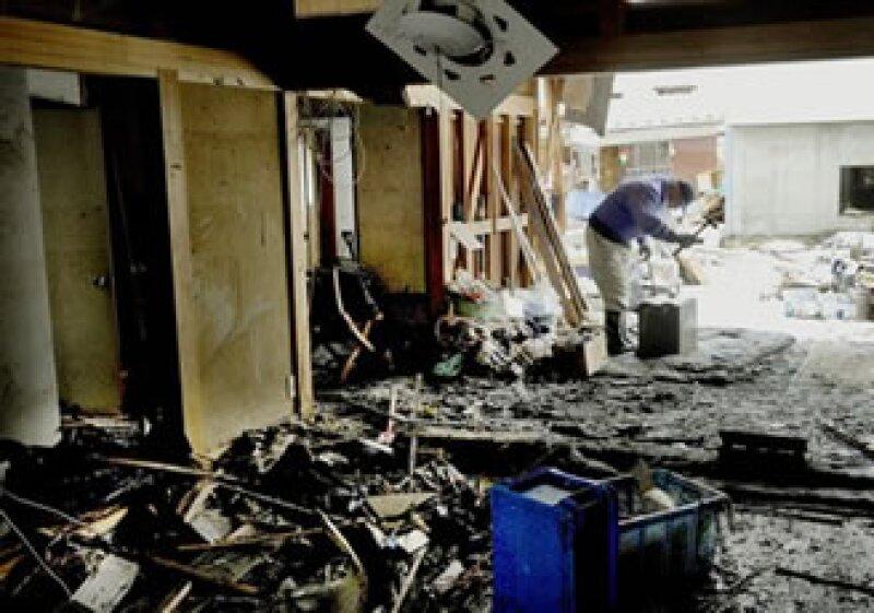 El Gobierno estima que sólo el daño material podría superar los 300,000 mdd. (Foto: AP)