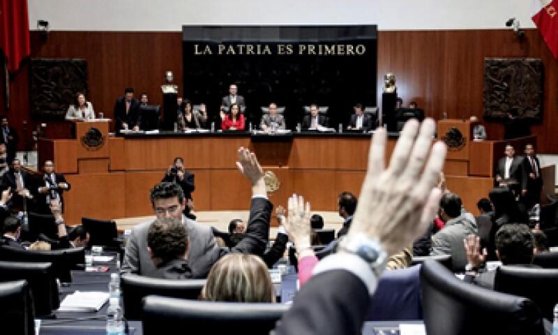 La votación de la miscelánea fiscal se dio sin la presencia de los senadores del PAN. (Foto: Notimex)