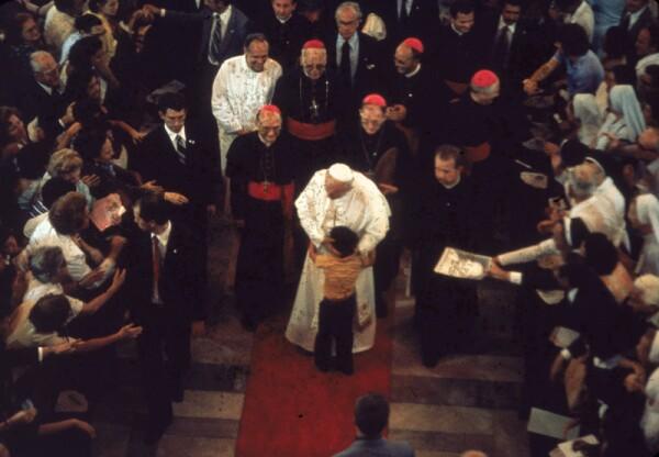 John Paul II Embraces Child