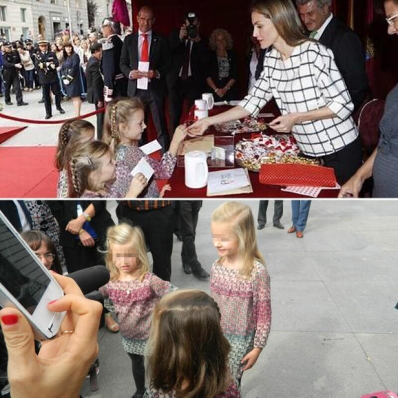 Estas pequeñitas vestidas y peinadas como la princesita de Asturias y la infanta Sofía se acercaron a saludar a la reina en `El día de la banderita´.