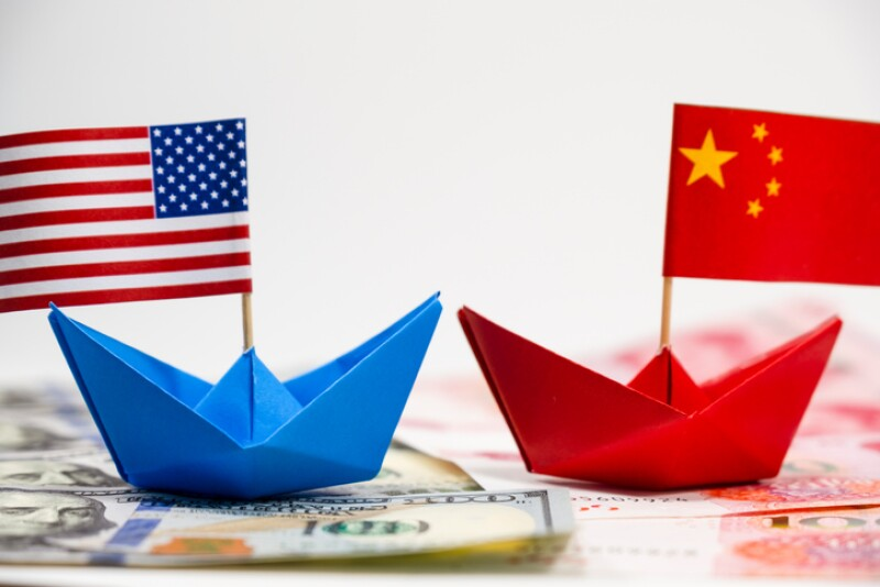 US America flag on blue ship and China flag on red ship and multi color flag with white background of war trade