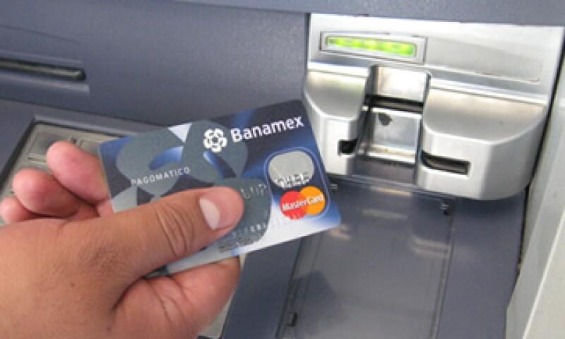 Banamex, BBVA Bancomer y Santandes, entre las financieras afectadas por la rebaja de la calificadora. (Foto: CNNExpansión)