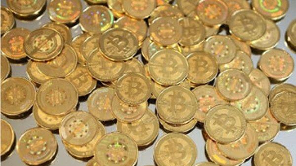 Los piratas informáticos han vulnerado las carteras digitales que guardan los bitcoins. (Foto: Cortesía CNNMoney.com)