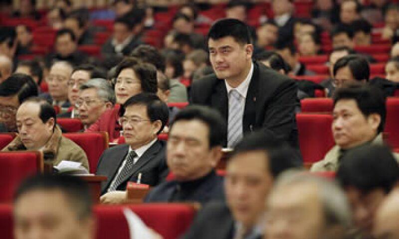 Yao Ming jugó nueve años en la liga profesional de basquetbol de EU. (Foto: AP)