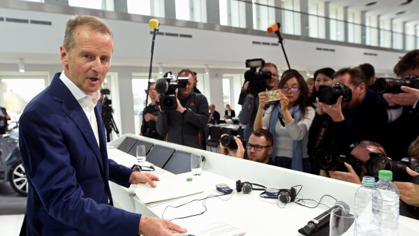 Herbert Diess, CEO of German carmaker Volkswagen is surrounded by media during the annual news conference at the Volkswagen plant in Wolfsburg