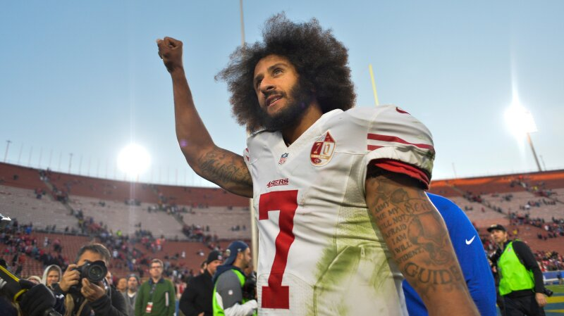 FILE PHOTO - Colin Kaepernick pumps his fist as he acknowledges the cheers at Los Angeles Memorial Coliseum in Los Angeles