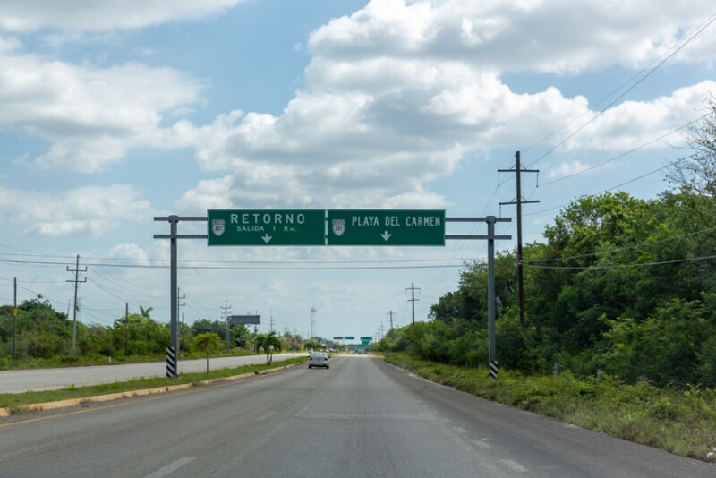 Mexican highway with green signs road