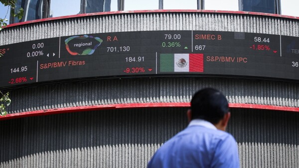 A pedestrian walks in front of the building of Mexico's stock exchange after Latin American stocks tanked amid continued concerns over the coronavirus disease (COVID-19), in Mexico City