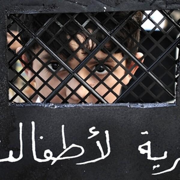siria, esclavitud, rejas, guerra, infancia, niños