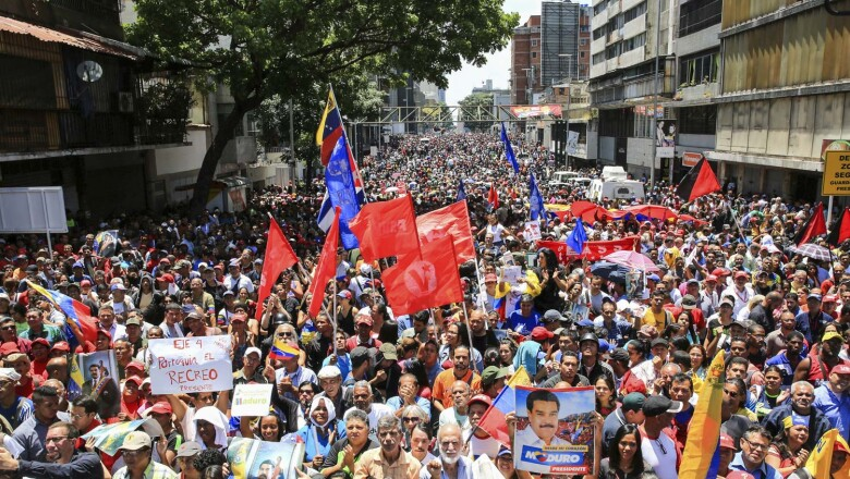 Supporters of Venezuela's President Nicolas Maduro take part in a rally in support of his government in Caracas
