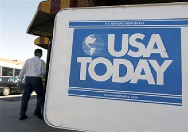 El año pasado, el diario tuvo 2,300 páginas de publicidad, casi la mitad de las que tenía en 2005. (Foto: AP)