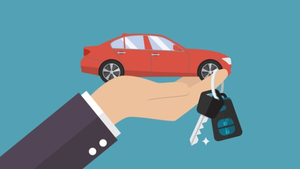 Hand holding car in palm and key on finger