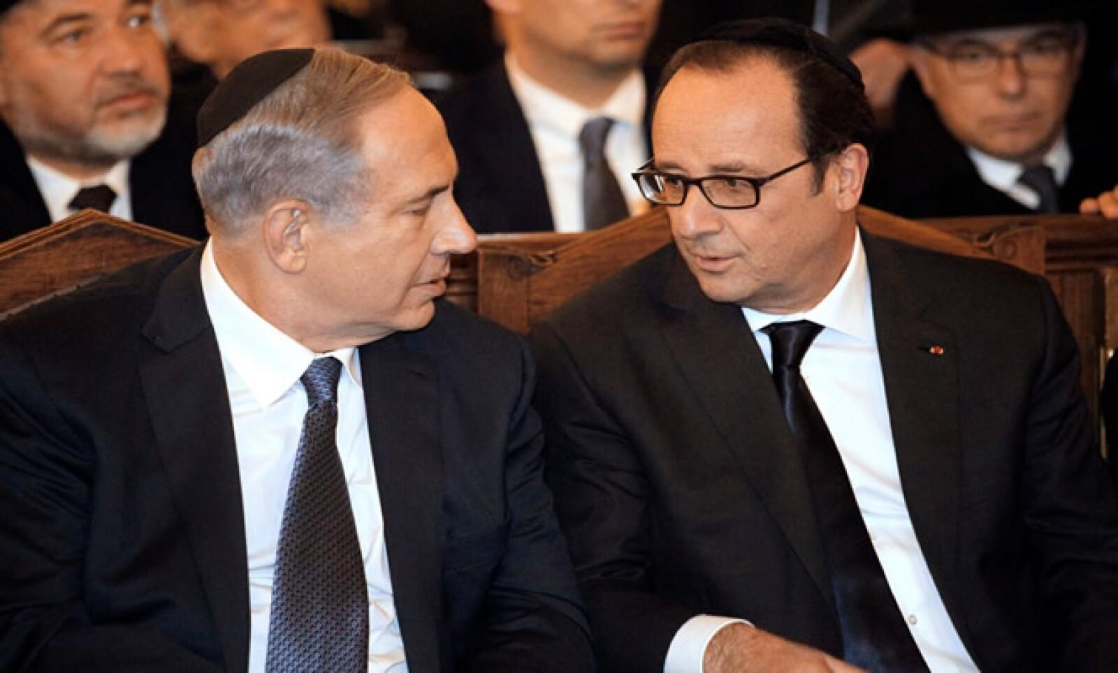 Benjamin Netanyahu se reunió con el presidente francés en una ceremonia en la Gran Sinagoga en honor a las víctimas de los ataques de esta semana.