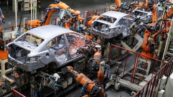 Robots weld bodyshells of car are pictured on the assembly line in the Proton manufacturing plant in Tanjung Malim