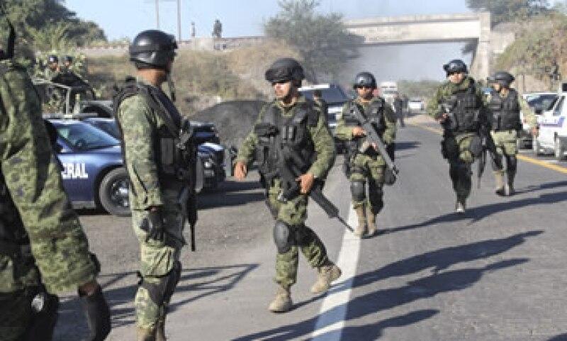 El Gobierno michoacano firmó un convenio con el Gobierno federal para tratar de paliar la violencia en el estado. (Foto: Cuartoscuro)