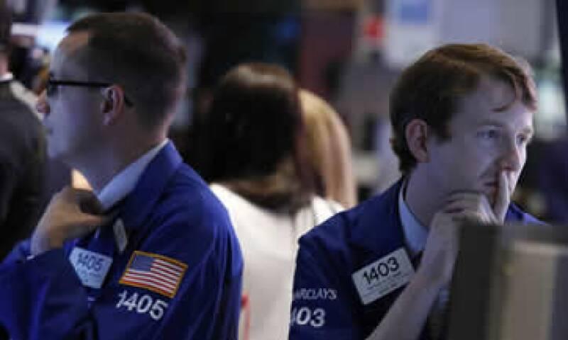 Los inversores buscan señales sobre alguna reducción del estímulo por 85,000 mdd mensuales de la Fed. (Foto: Reuters)