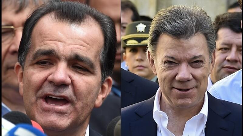 El derechista Óscar Iván Zuluaga (izquierda) y Juan Manuel Santos (derecha), presidente de Colombia, durante la emisión de su voto este domingo