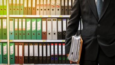 businessman holding data files