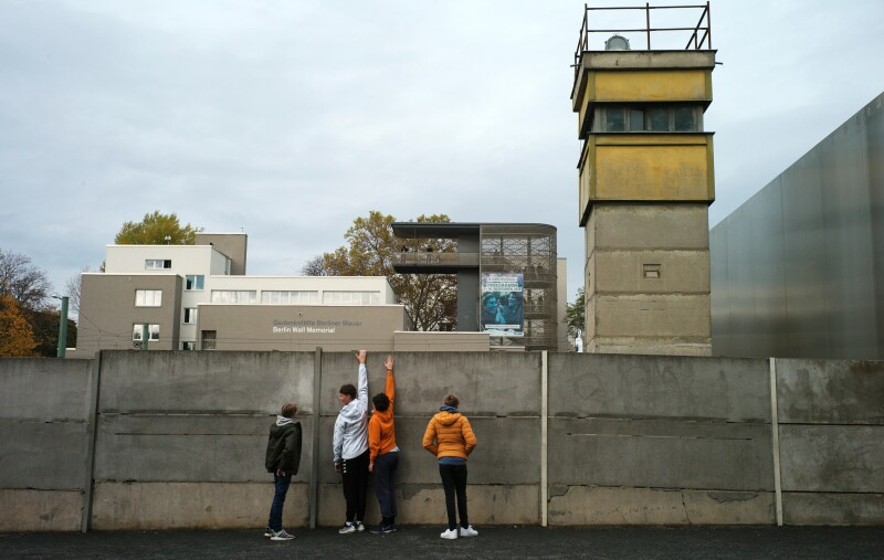 People visit remains of the Berlin Wall at the Wall memorial on Bernauer Strasse in Berlin