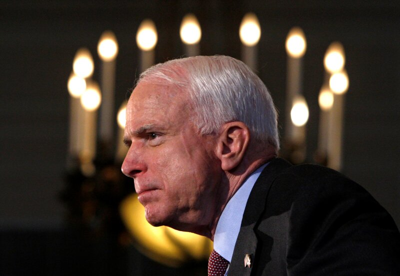 FILE PHOTO -  Presumptive Republican presidential candidate US Senator John McCain listens to a question during a news conference in Ottawa