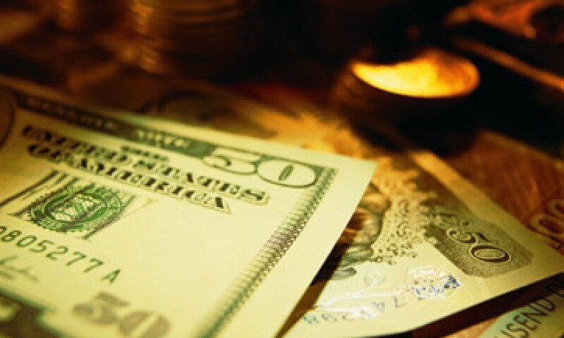 El tipo de cambio es de 13.2087 pesos, para solventar obligaciones denominadas en moneda extranjera: Banxico. (Foto: Thinkstock)