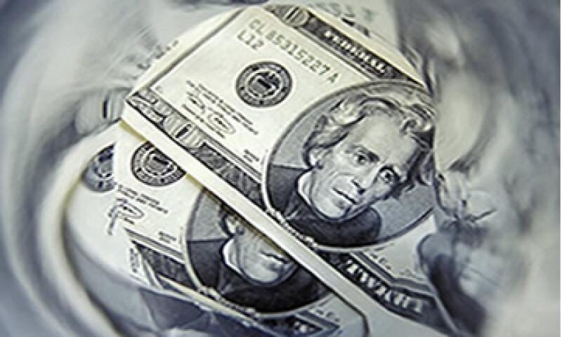 Desde hace tres años, el tipo de cambio del peso frente al dólar se ha visto amenazado por las crisis aún sin resolver en  Europa y EU. (Foto: Photos To Go)