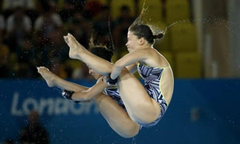 El entrenador de las saltadoras sincronizadas de trampolín canadienses también es usuario de Videopix. (Foto: AP)
